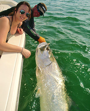 Happy woman with tarpon caught off Boca Grande with Captain Jesse.