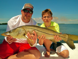 Father and son holding snook caught off Boca Grande.