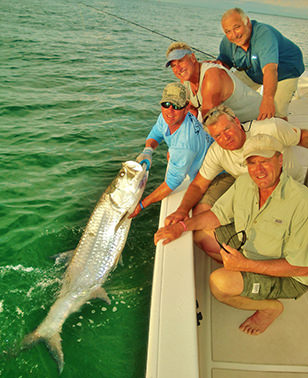 Group with tarpon caught off Boca Grande with Captain Jesse.
