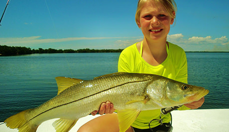 Girl holding large snook caught with Capt. Jesse and Capt. Kelly in Englewood, Florida.